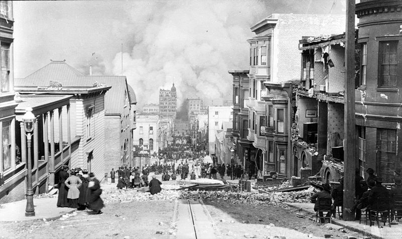Street photograph of a crowd watching a fire during the 1906 San Francisco Earthquake