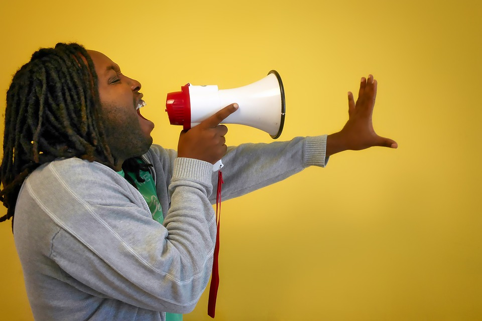 A man using a megaphone.